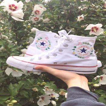 Hand embroidered white high top converse, size 6 women's. The inside (with the chuck taylor / con