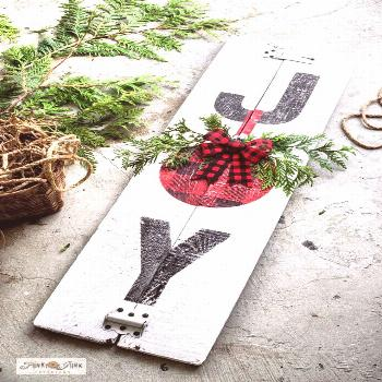 Learn how easy it is to stencil this festive Joy Buffalo Check Christmas sign on reclaimed wood wit