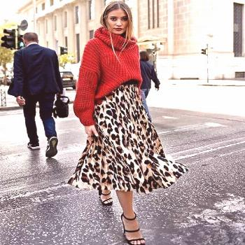 Red is Christmas. Animal print is for fashion | How to Wear Your Christmas Sweater with Style